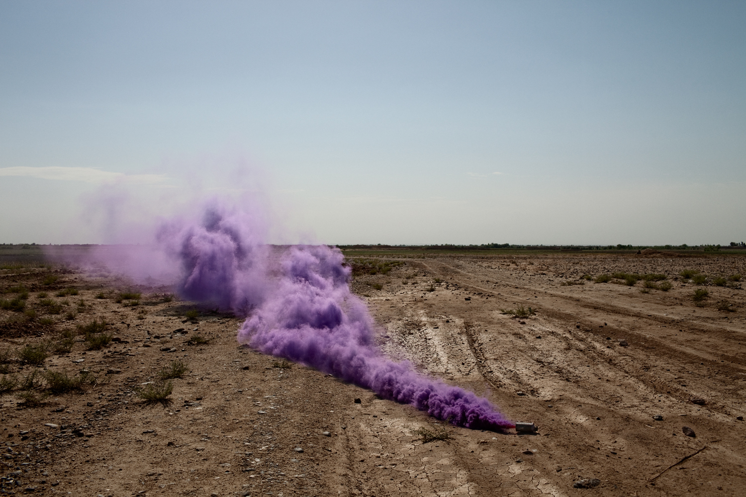 A U.S. Marine flare marks a landing zone for a medical evacuation helicopter near Patrol Base Beatley in Marja District, Helmand Province, Afghanistan.