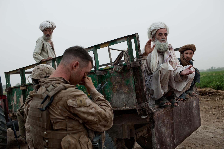 U.S. Marine Lieutenant Kevin Gaughan meets family members of Gulmakay, a fourteen-year old Afghan girl killed by a U.S. Marines mortar strike, in Abdullah Jan Village, Marja District, Helmand Province, Afghanistan.
