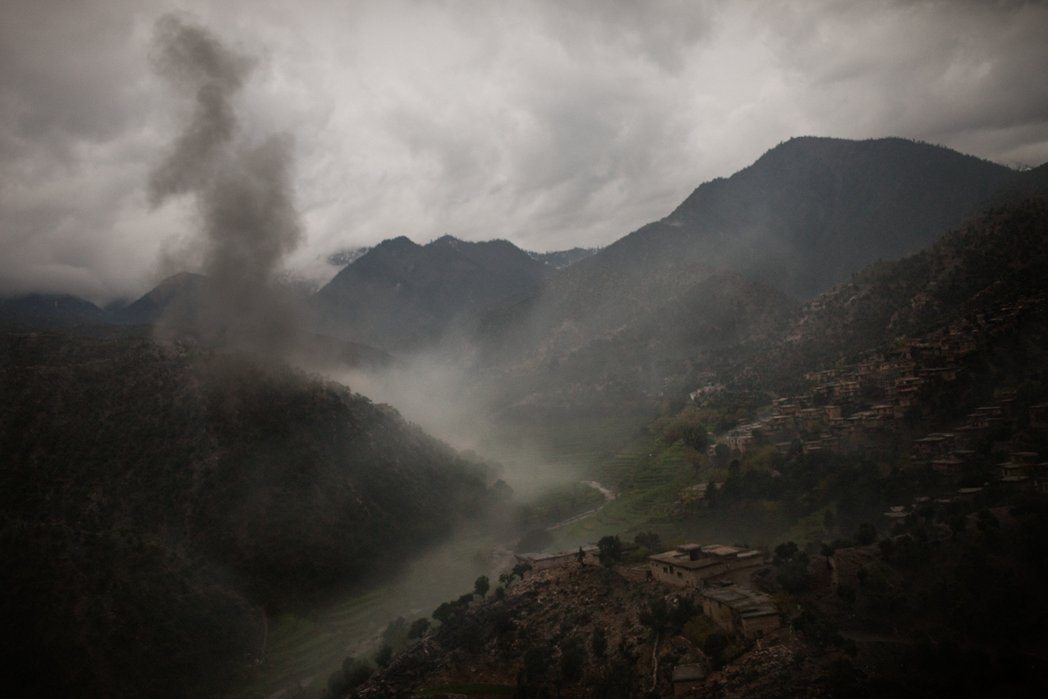 Smoke rises from a U.S. bomb that was dropped after a U.S. Army solider was killed in an improvised explosive device attack in the Korengal Valley, Kunar Province, Afghanistan.