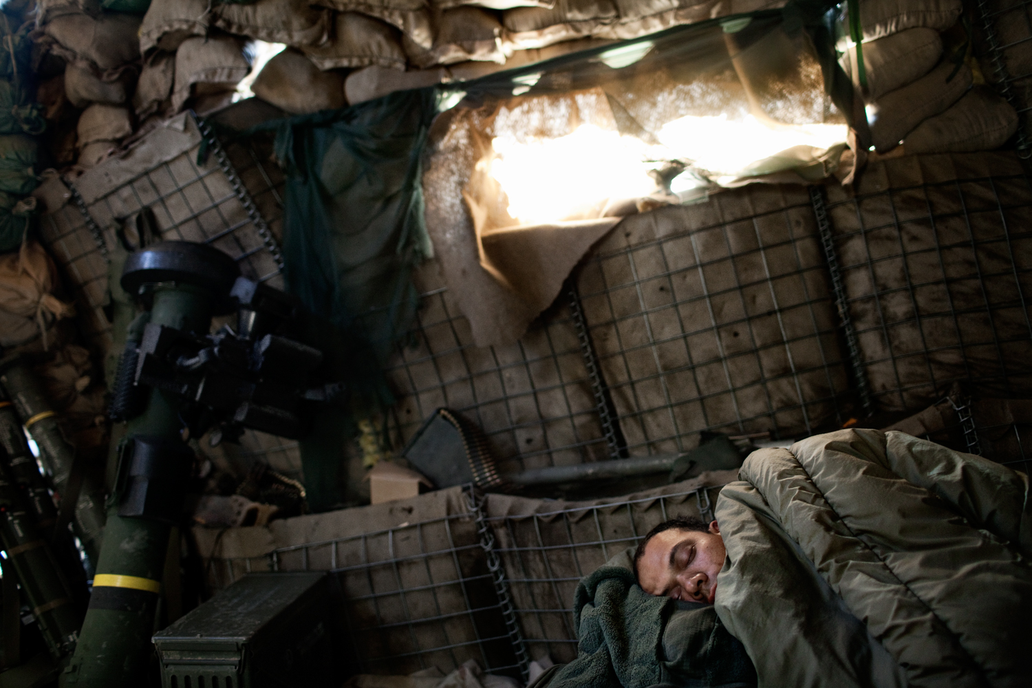 A U.S. Army sergeant sleeps at Observation Post Dallas in the Korengal Valley, Kunar Province, Afghanistan.