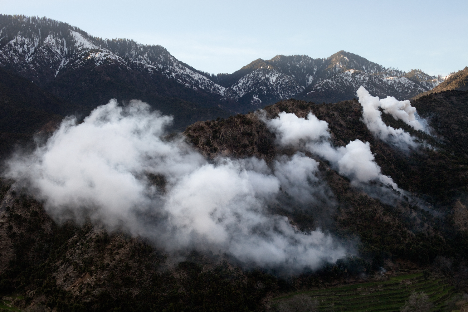 Smoke clouds from white phosphorous mortars fired by U.S. Army in the Korengal Valley, Kunar Province, Afghanistan.