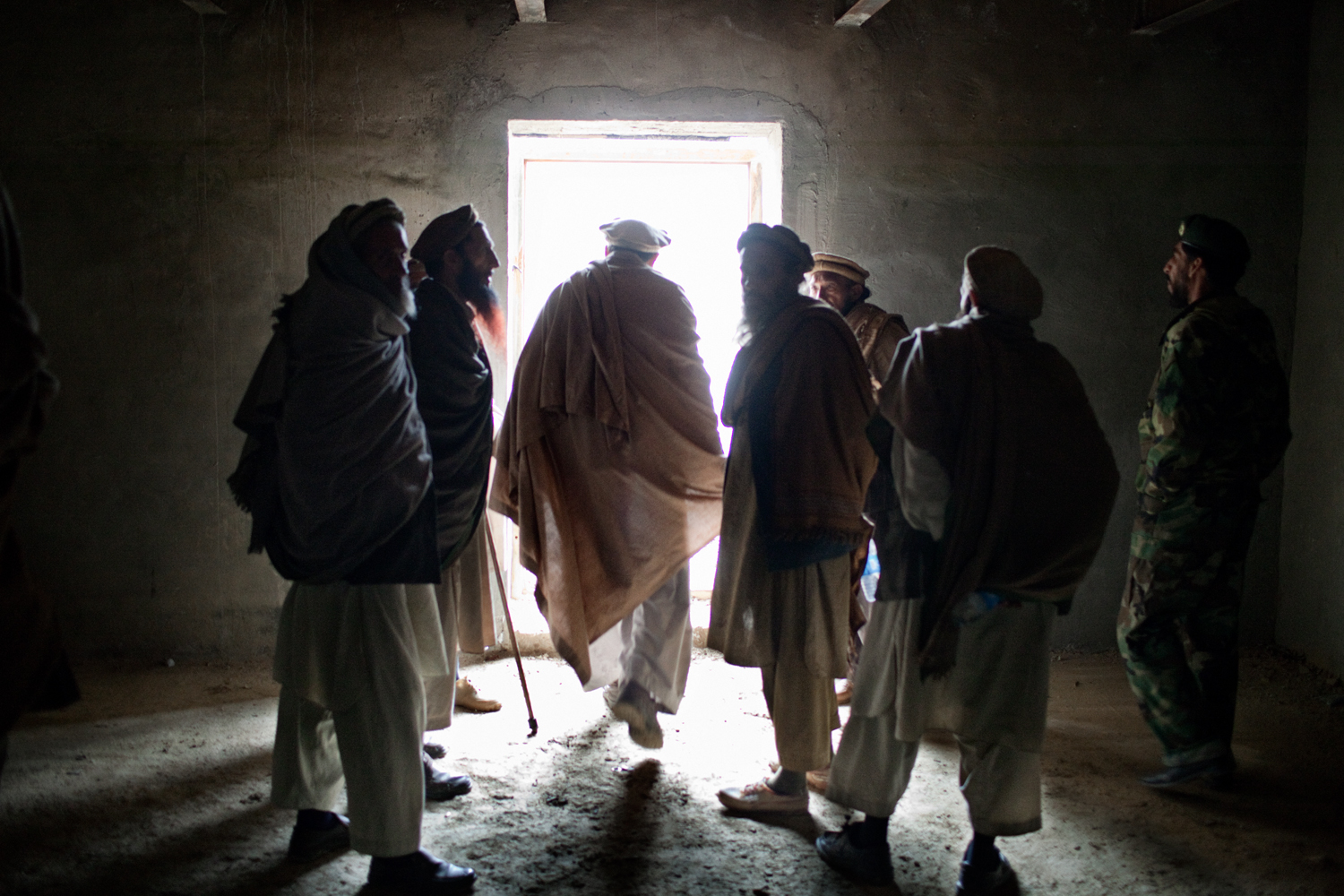 Village elders leave a meeting with U.S. Army soldiers after seeking compensation for battle damage and the release of a detained local, at the Korengal Outpost, Kunar Province, Afghanistan.