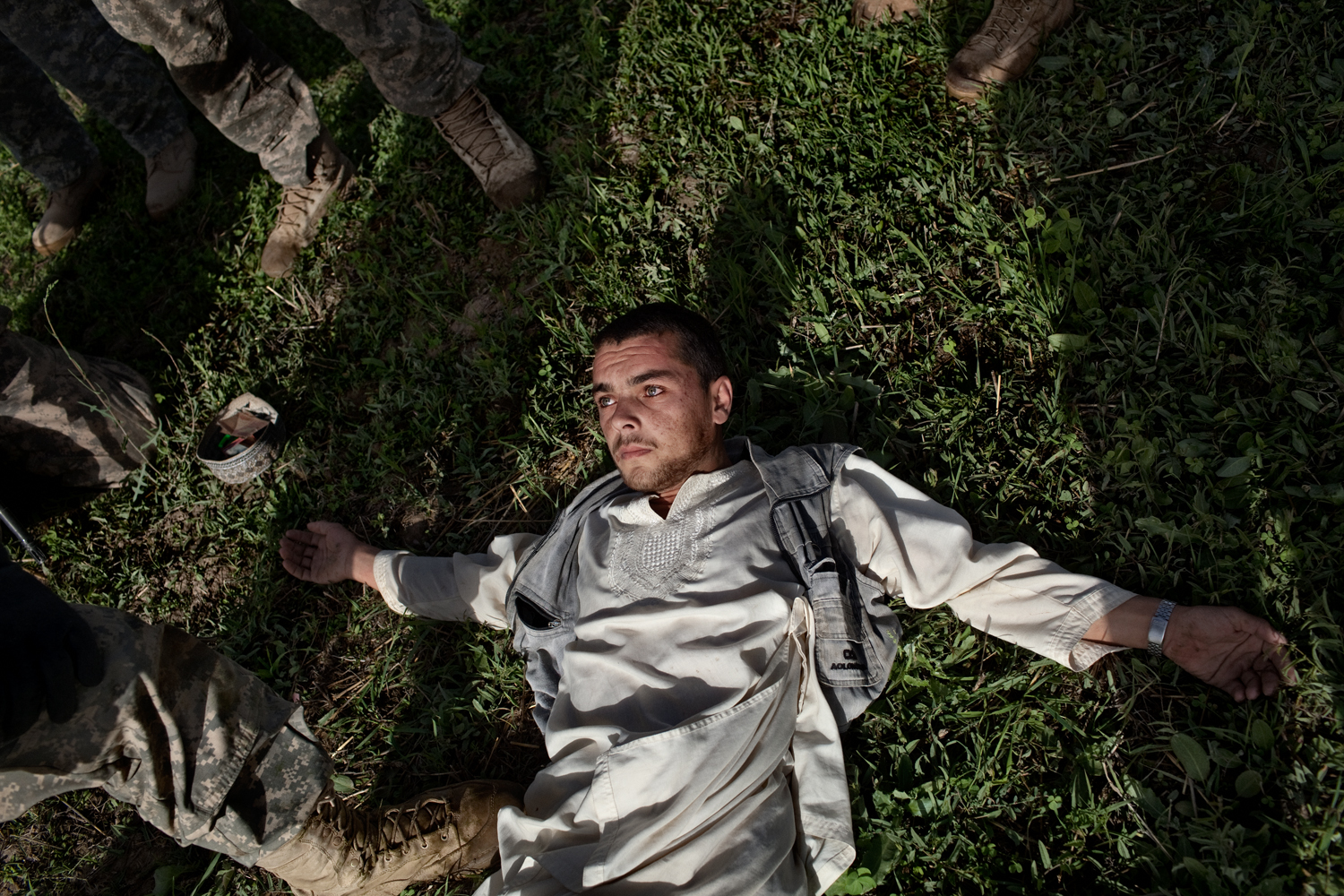 An Afghan man is searched by U.S. Army in the Tangi Valley, Wardak Province, Afghanistan.