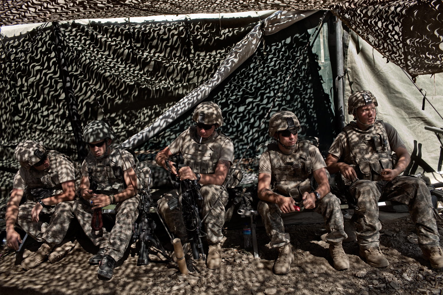 U.S. Army soldiers stand down at Combat Operations Post Tangi after it came under rocket attack in the Tangi Valley, Wardak Province, Afghanistan.