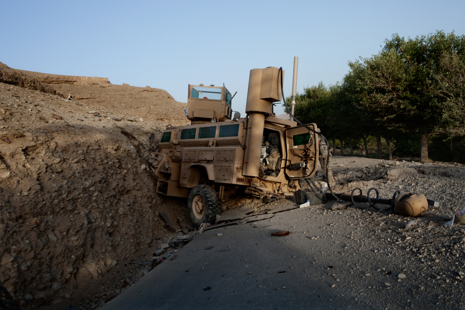 A Mine Resistant Ambush Protected Vehicle sits on the road after being attacked by an improvised explosive device in the Tangi Valley, Wardak Province, Afghanistan.