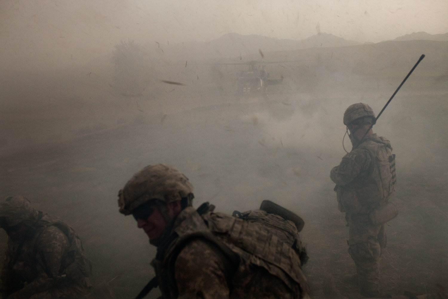 Medical evacuation helicopters land to evacuate three U.S. Army soldiers injured in an improvised explosive device attack on their vehicle in the Tangi Valley, Wardak Province, Afghanistan.