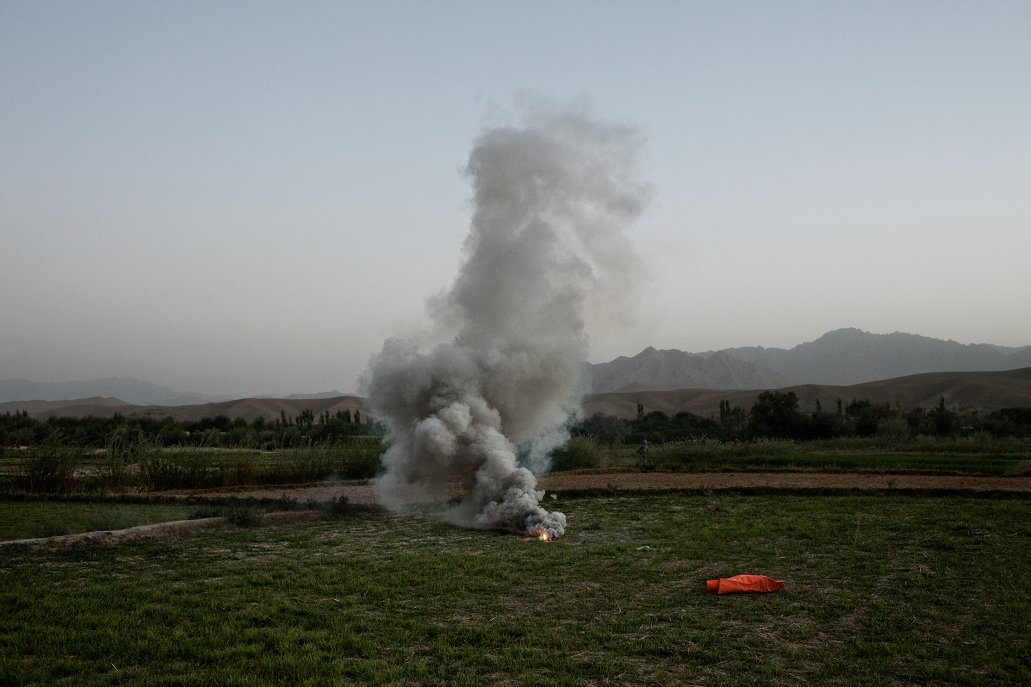 A flare marks a landing zone for medical evacuation helicopters after three U.S. Army Soldiers were injured in an improvised explosive device attack in the Tangi Valley, Wardak Province,Afghanistan.