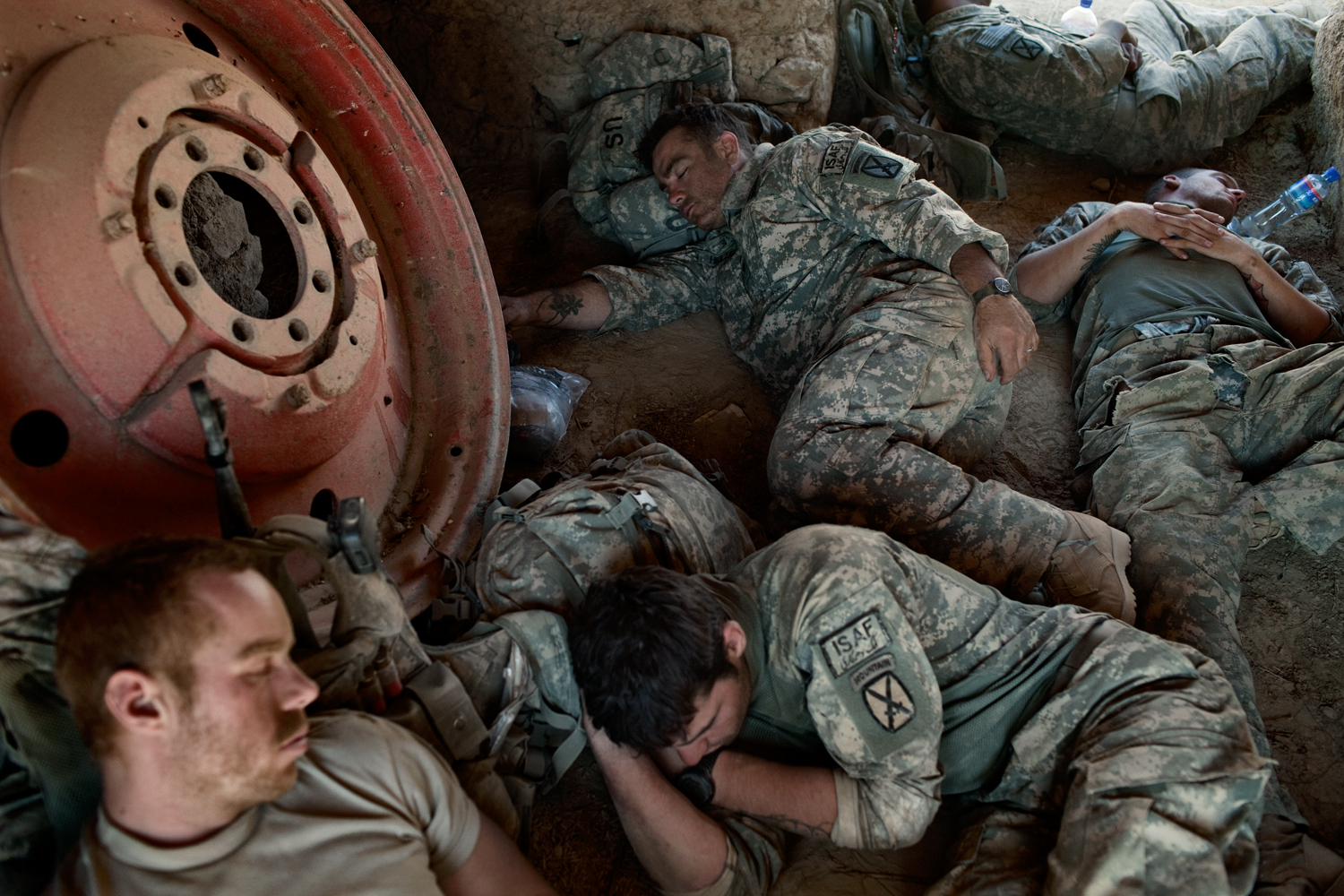U.S. Army soldiers sleep at a temporary patrol base during an operation in the Tangi Valley, Wardak Province,Afghanistan.