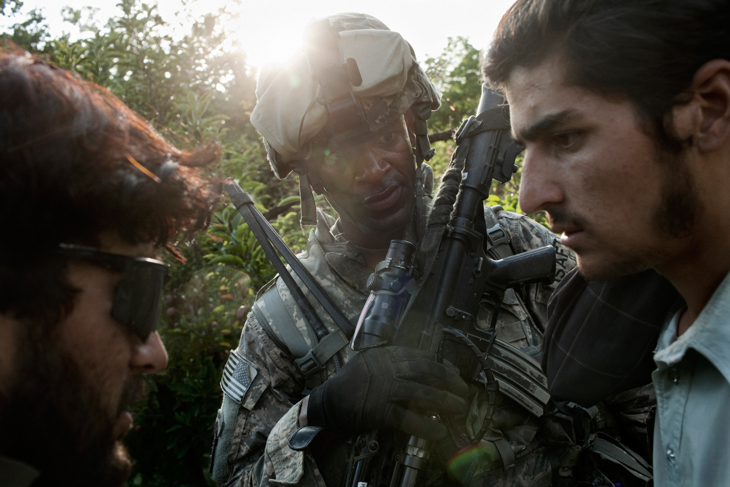 A U.S. Army soldier and Afghan interpreter question a local villager in the Tangi Valley, Wardak Province, Afghanistan.