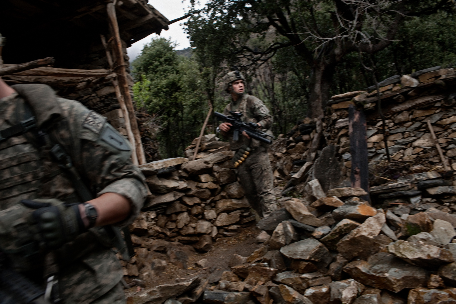 U.S. Army soldiers patrol near Loi Kolay village in the Korengal Valley, Kunar Province, Afghanistan.