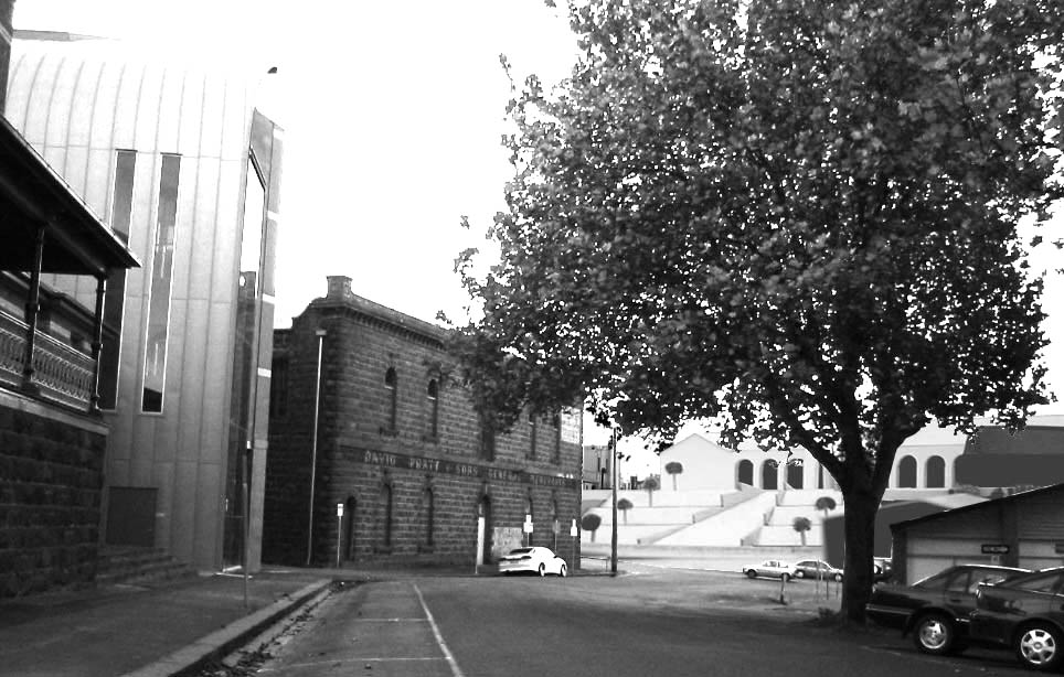View from Camp street looking towards Mair Street. What you would see with the removal of the car yards and a grand stairway linking the grand facade of the railway station directly to the city.