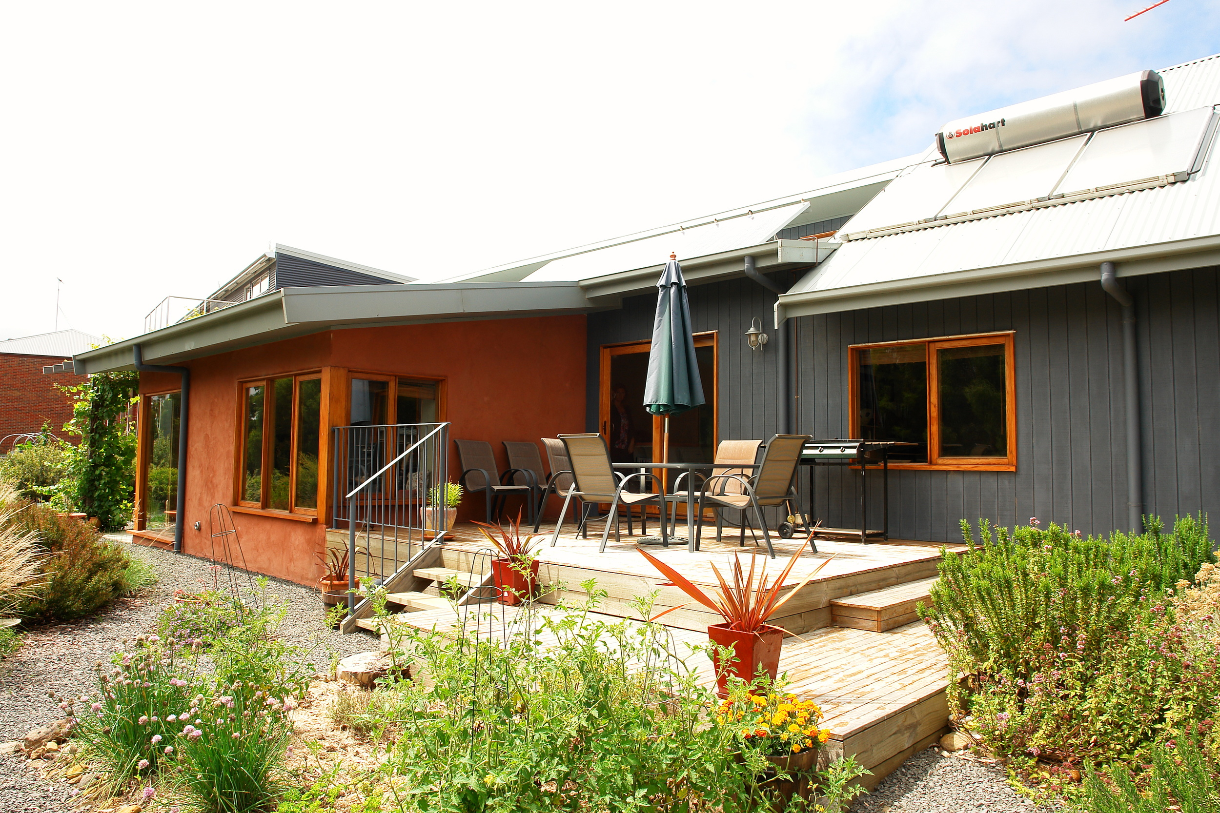 Marpeang: Rendered strawbale, split-level integrated into the site, solar power, super low energy modern eco-house.