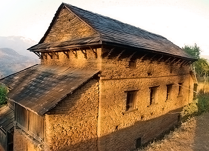 Traditional Nepali hill house with eaves to shade the walls and a steep slate roof to disperse the rainwater.