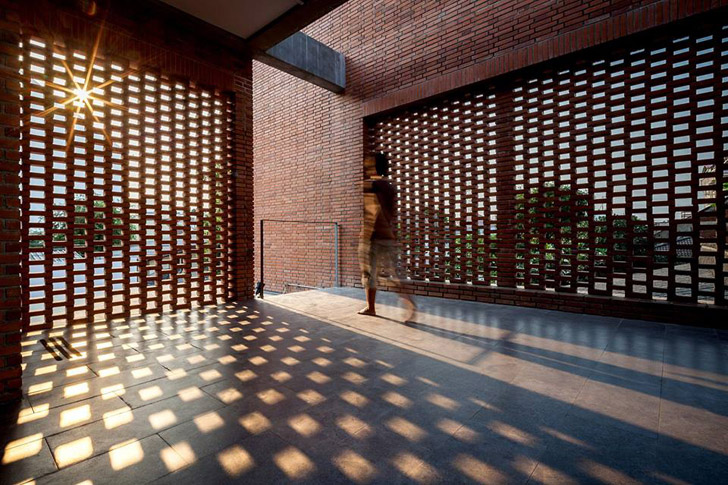 Creative voids in brick walls can create shade and capture breazes in semi-open courtyard spaces.