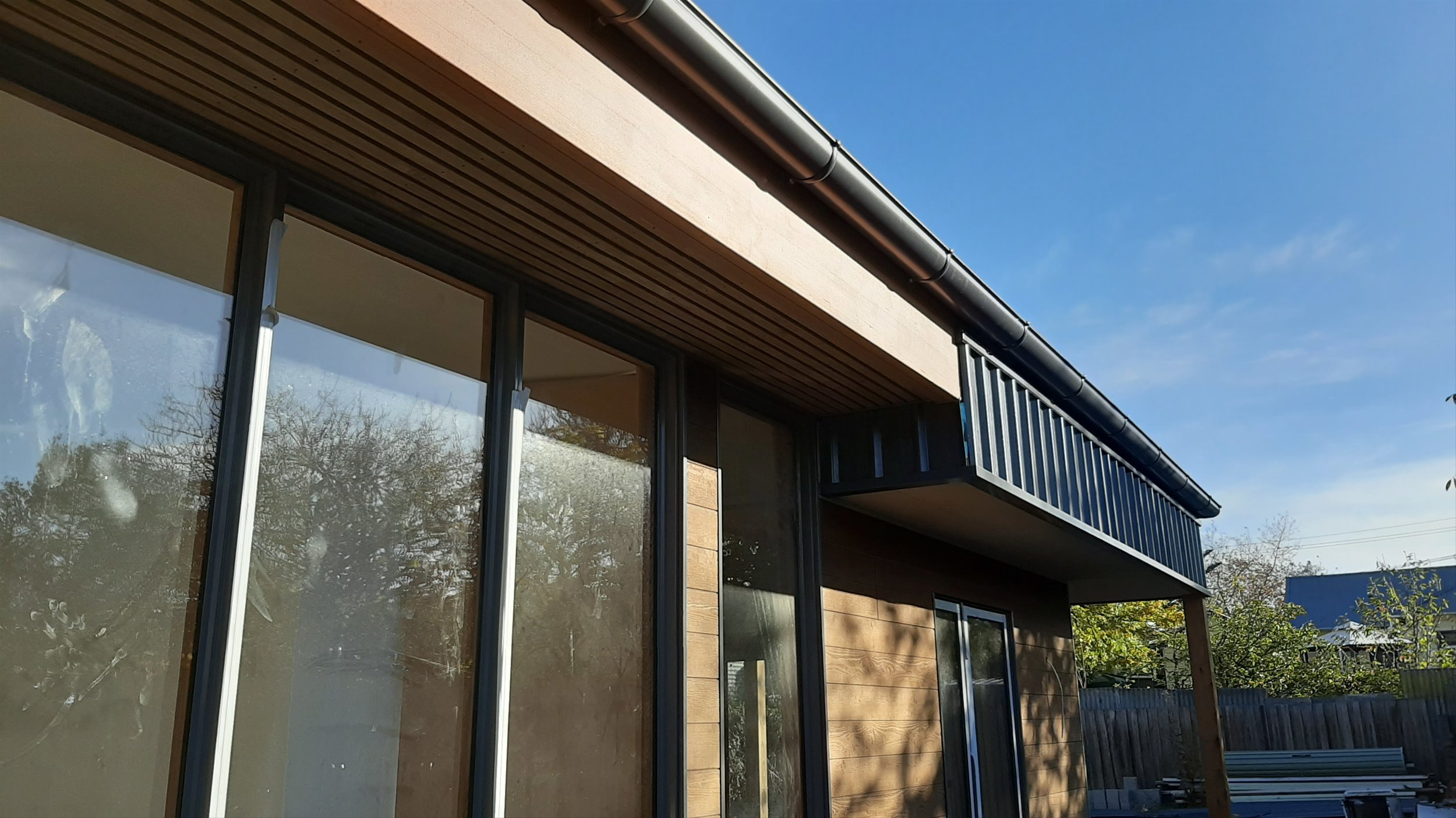 North facing window shading and roof ventilation grille.