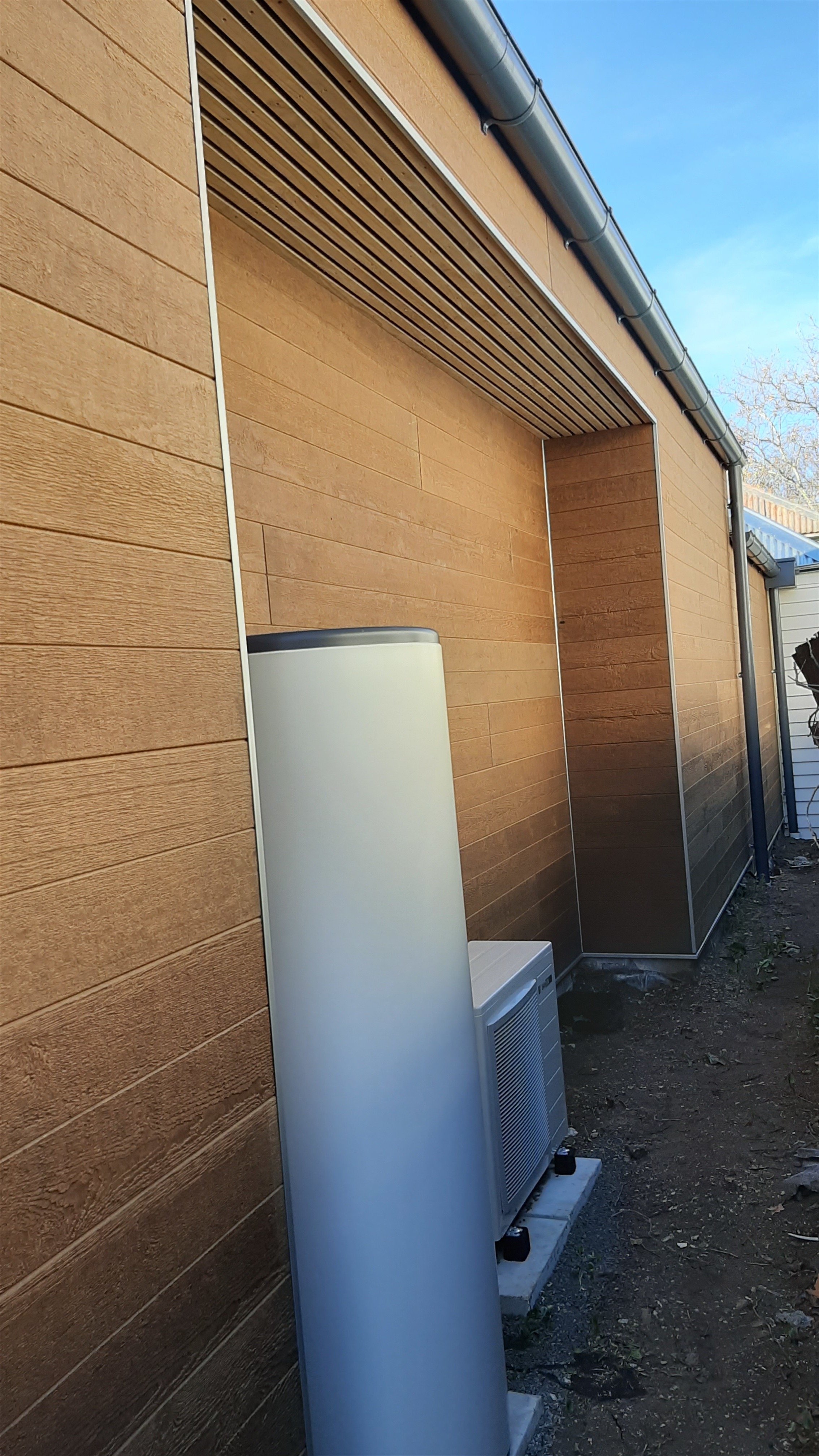 The open battens under the soffit allow fresh air to vent through the roof. This cools the building in summer and also remove moist air and condensation.