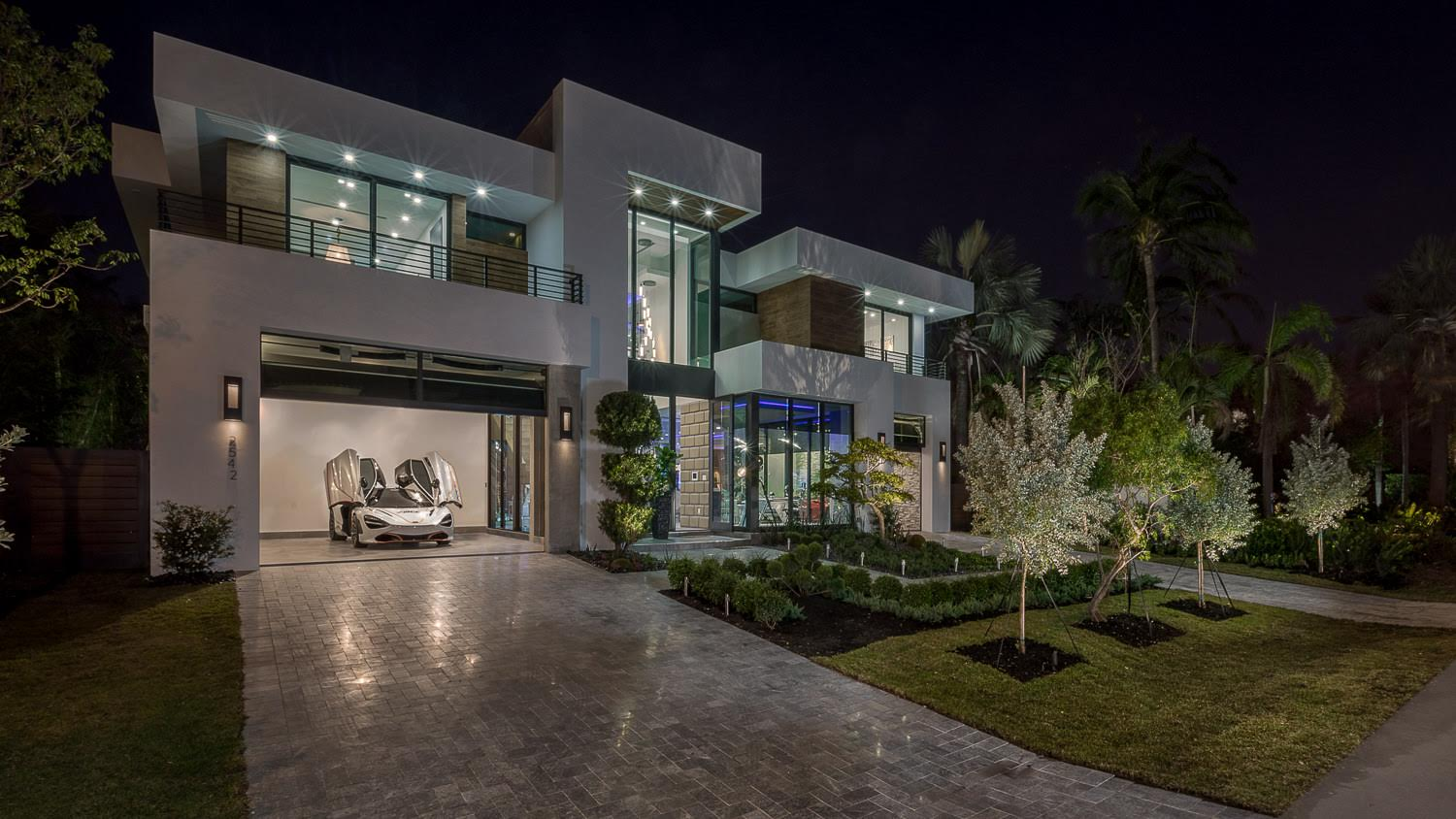 Our latest build.2542 Aquavista Blvd - 7200 sq. ft under air, 9300 sq. ft total. 90' waterfront x 130' deep.5 bedrooms, gym, office, lounge area, huge covered patio, elevator, new seawall and dock.