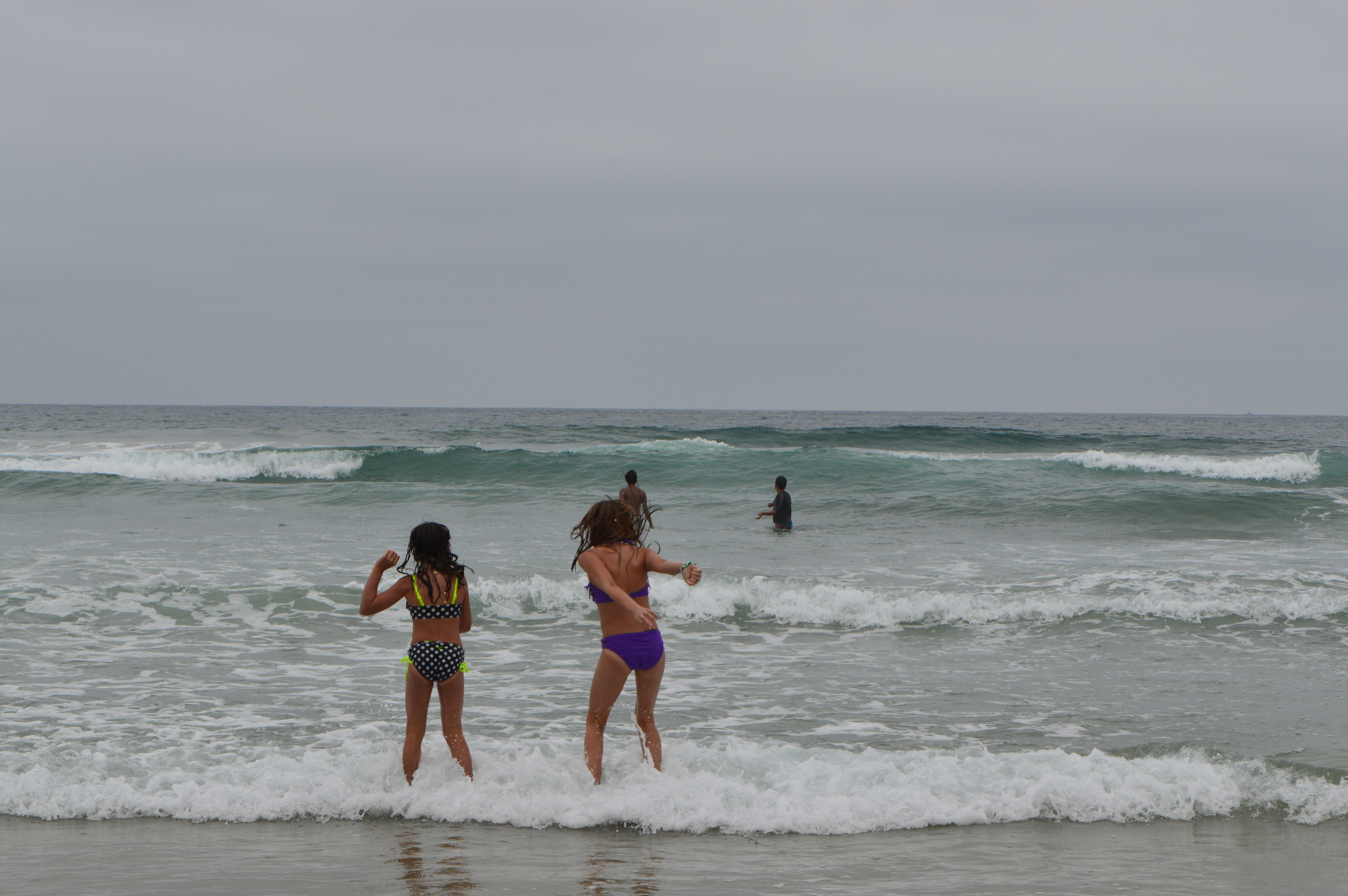 Beach, salty water and sand and the joy of watching my daughters play!