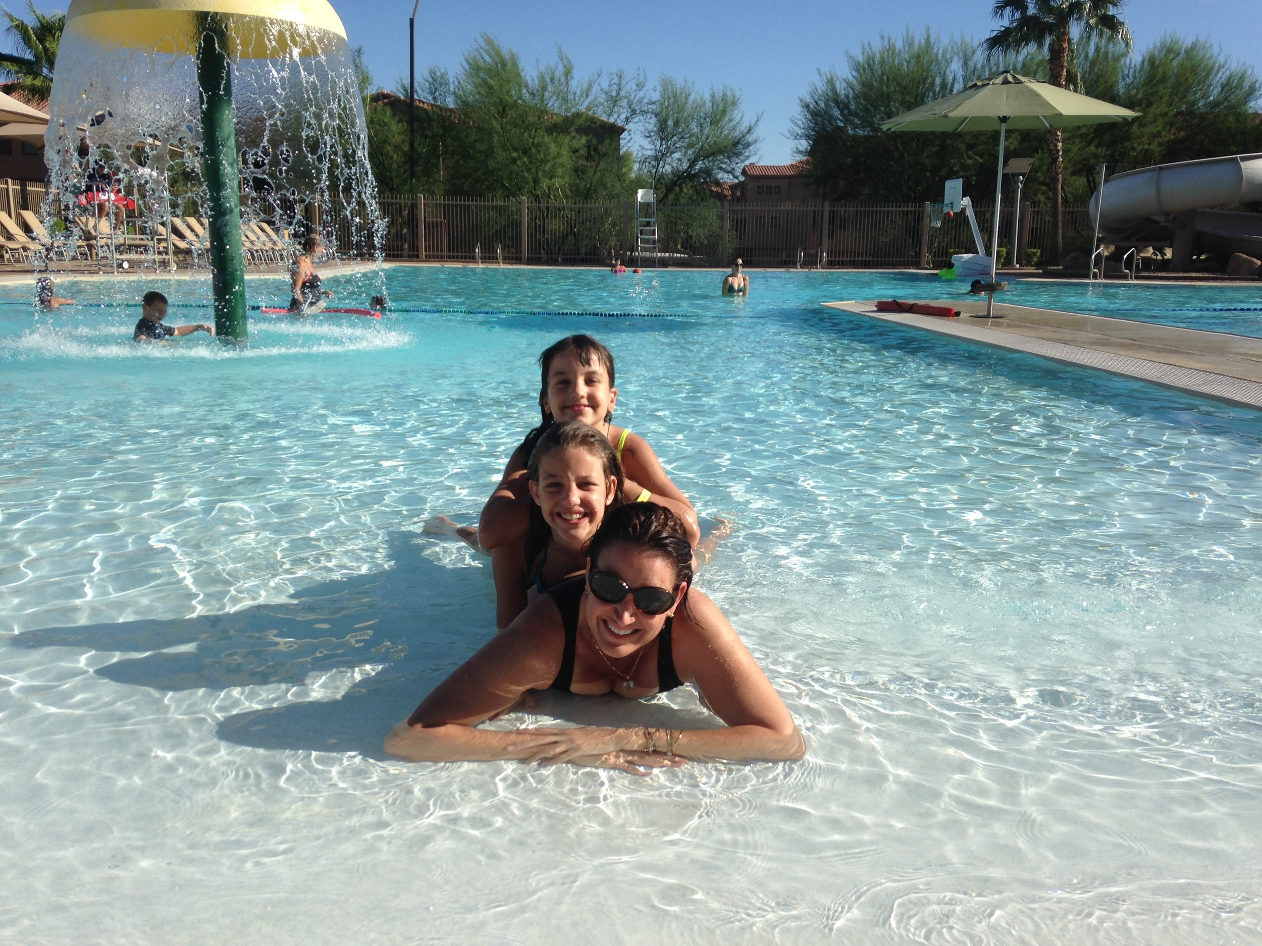 Cooling down with my daughters at the pool