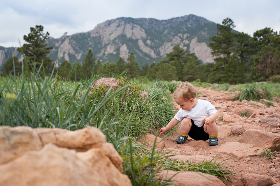 My son at 18 months collecting rocks on a trail near home.