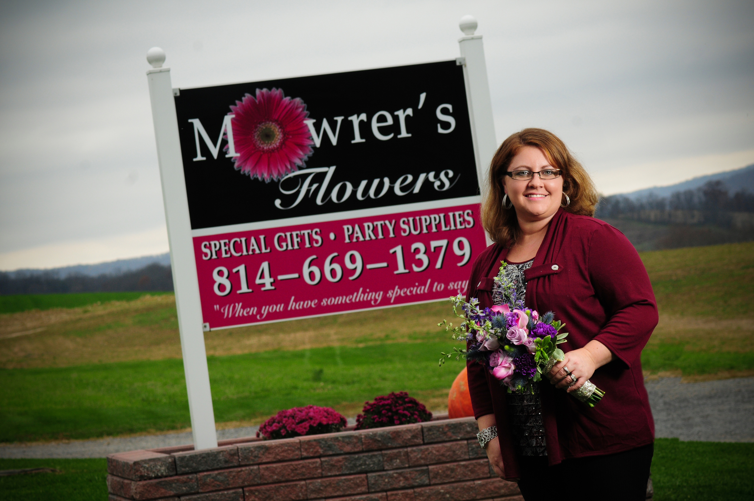 Erica Mowrer, owner and head designer, on the family farm in Petersburg, PA
