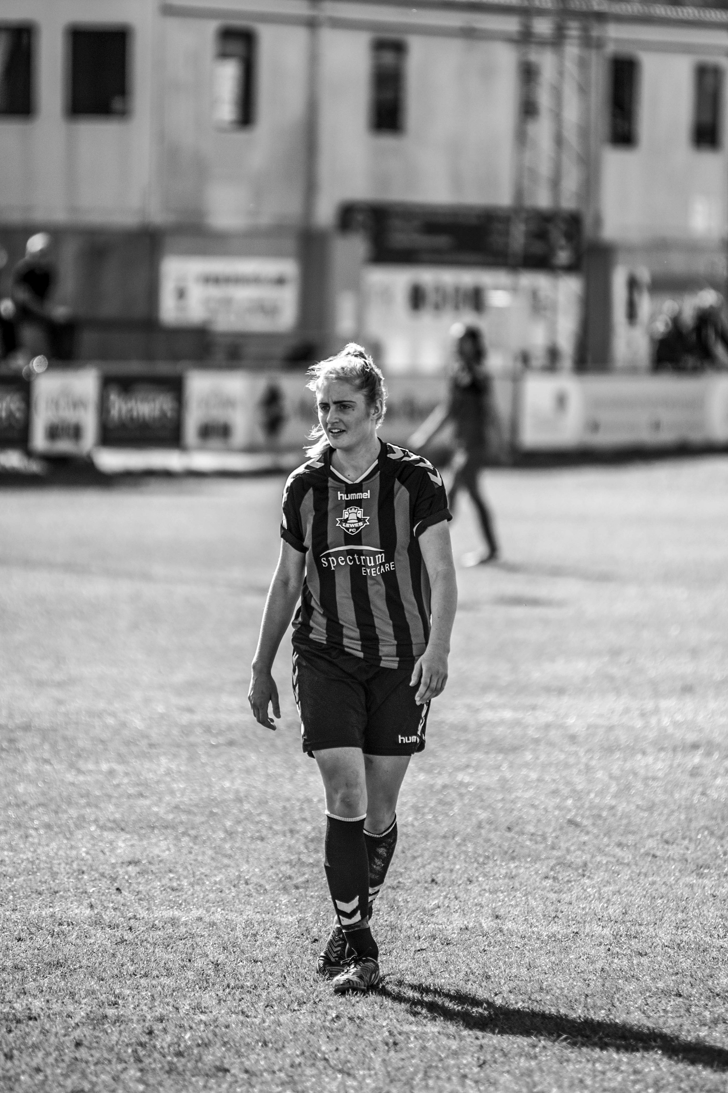 Woman footballer walking.jpg