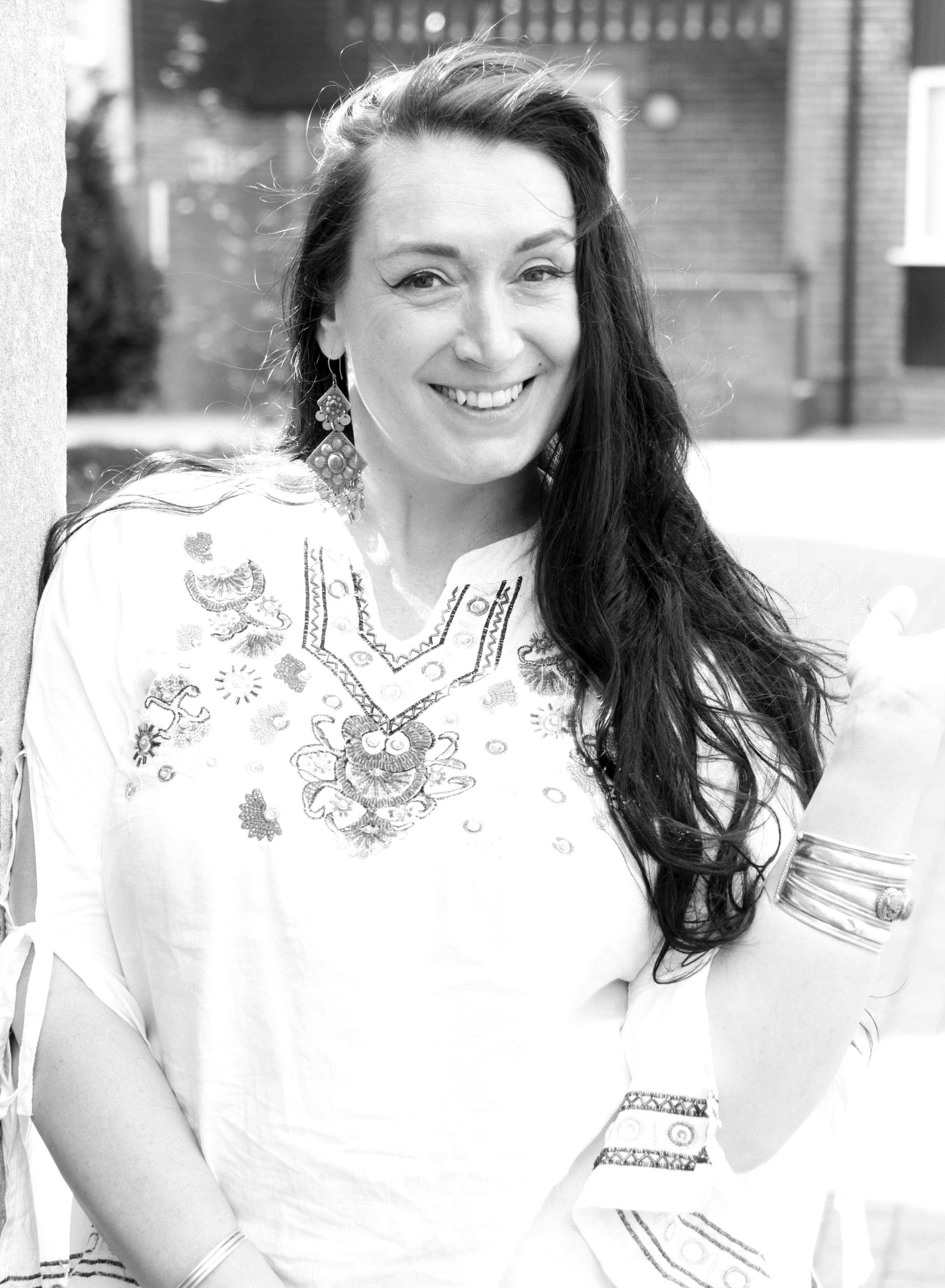 Black and white photo of woman in embroidered blouse