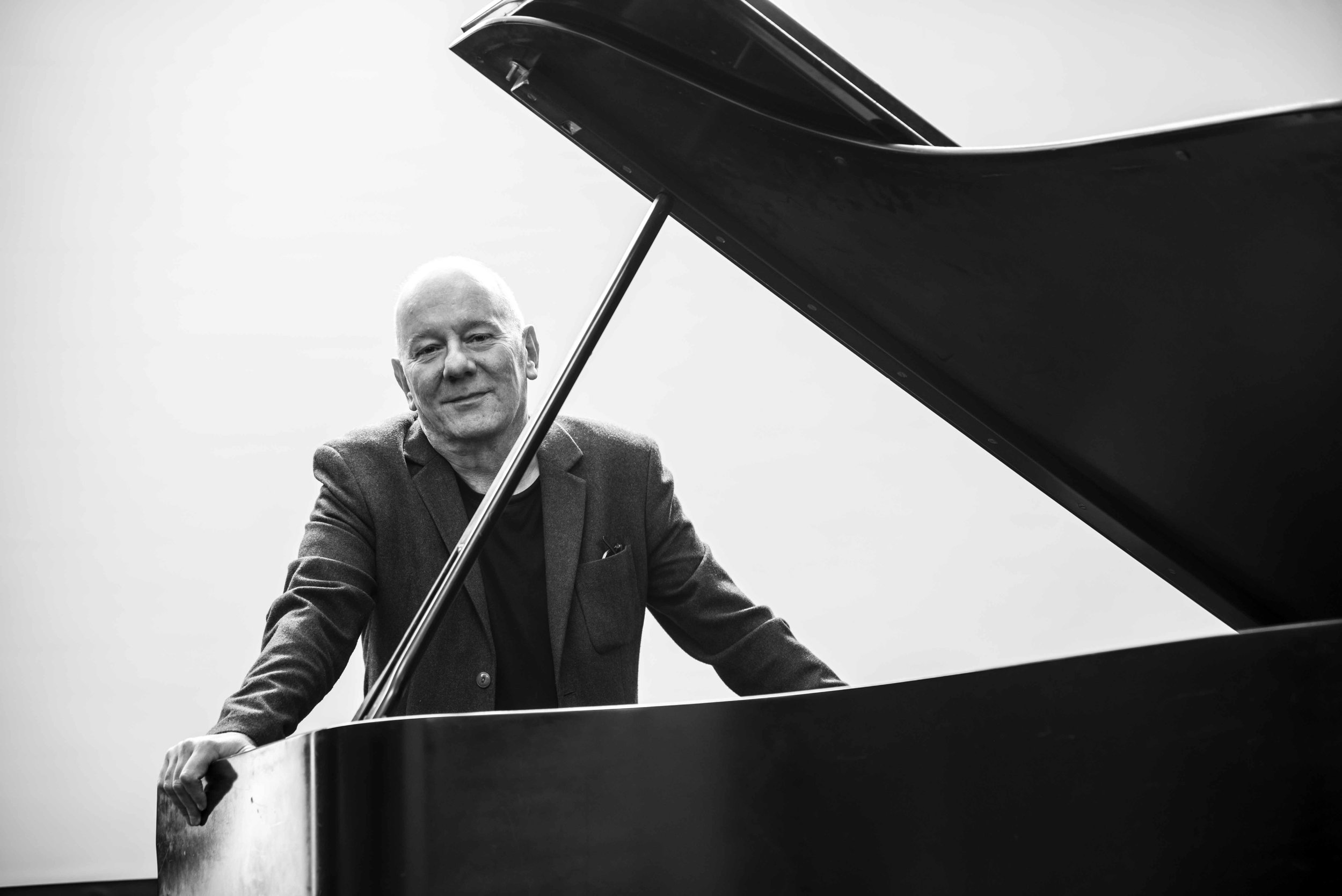 Contemporary composer Martin Butler at a grand piano.jpg