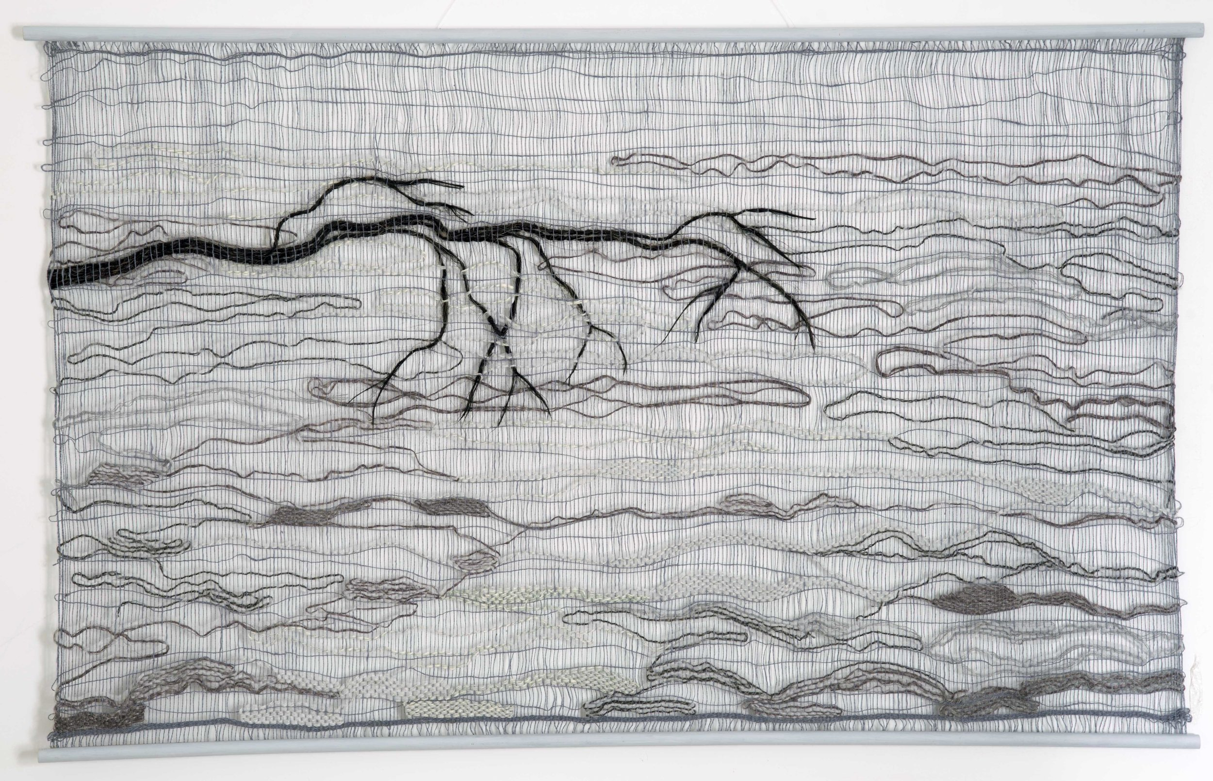 Pells Fog  by artist Jackie Bennett. created using an open weaving technique, woven in cotton, horse hair and other materials