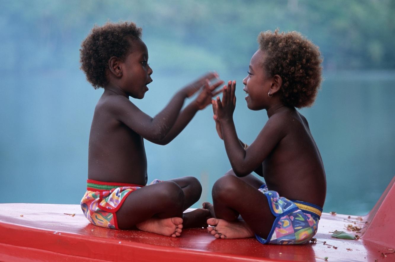 Girls playing clapping game, Melanesia (Simon Foale)