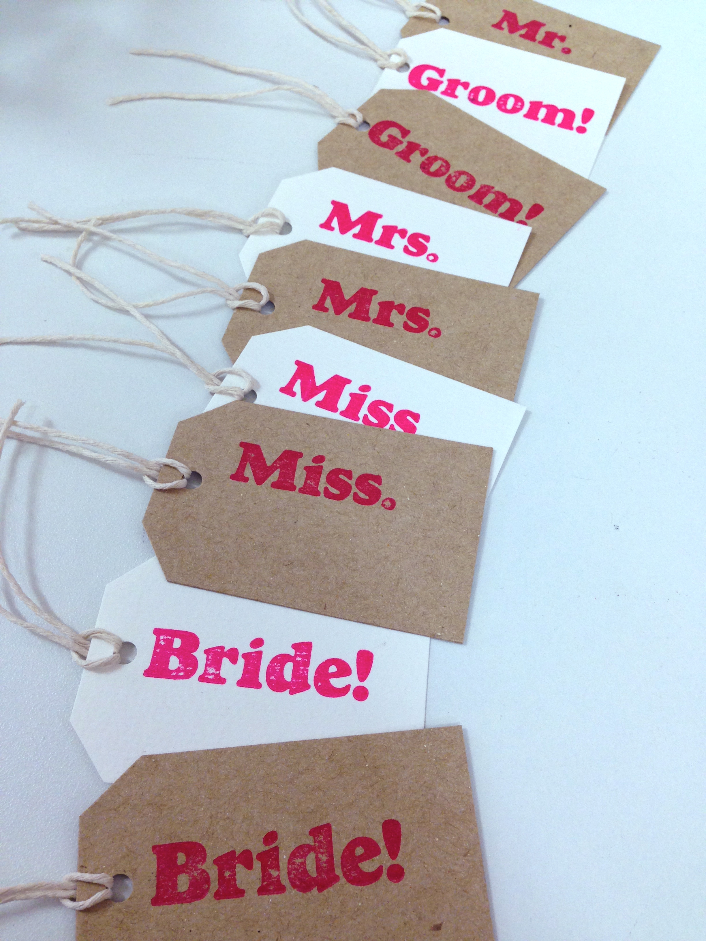 fluro pink wedding tags
