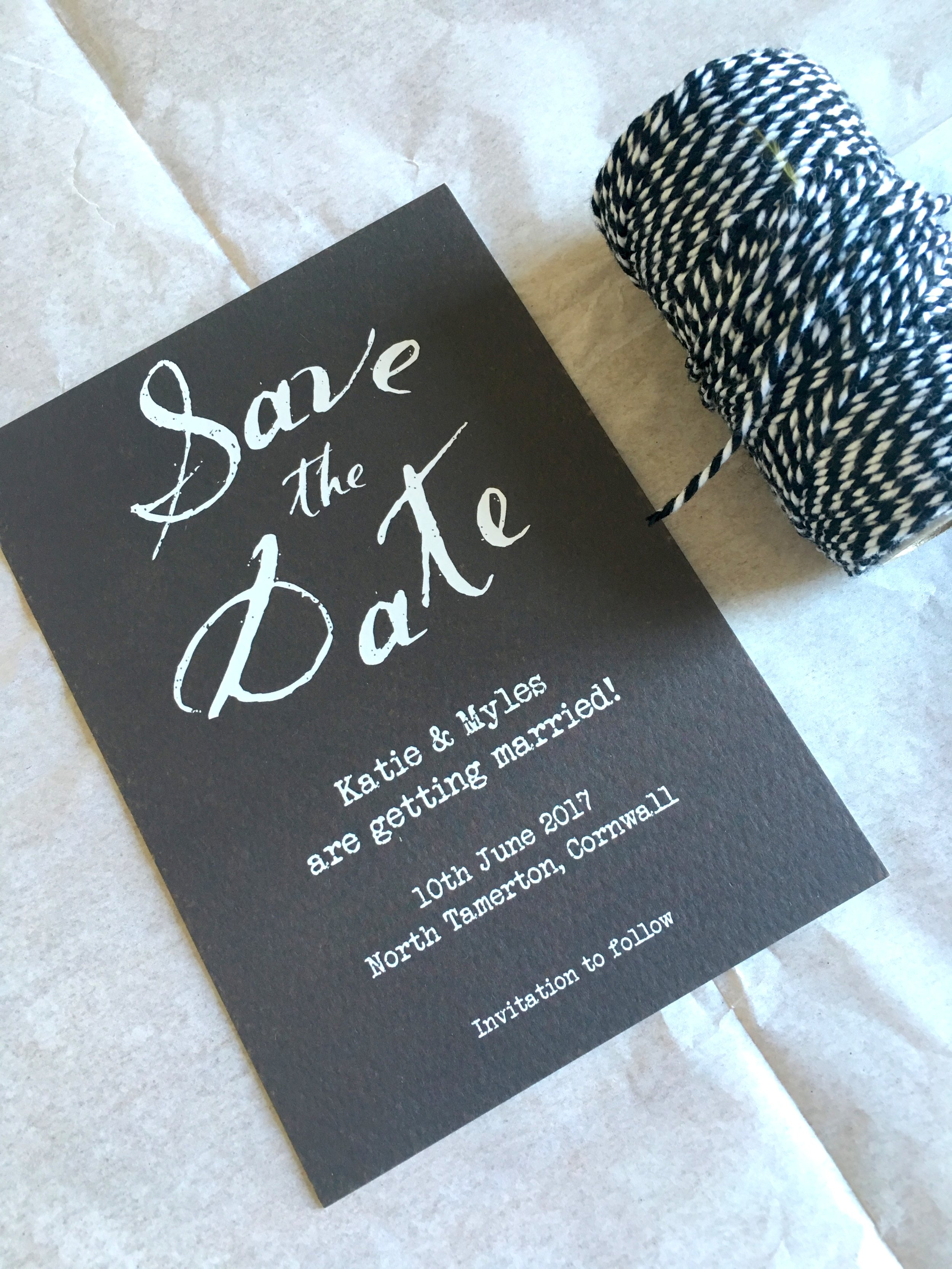 grey and white save the date card