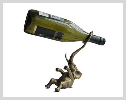 Menagerie Antique Brass Bottle Holders, $125