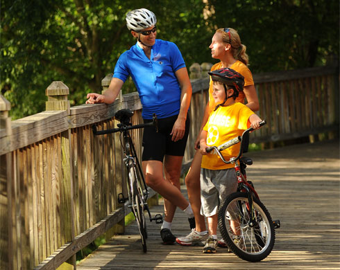 Catawba River Greenway features  3.8 miles of paved walking trail following the river through wooded and open areas.     http://discoverburkecounty.com/venue/catawba-river-greenway-park/