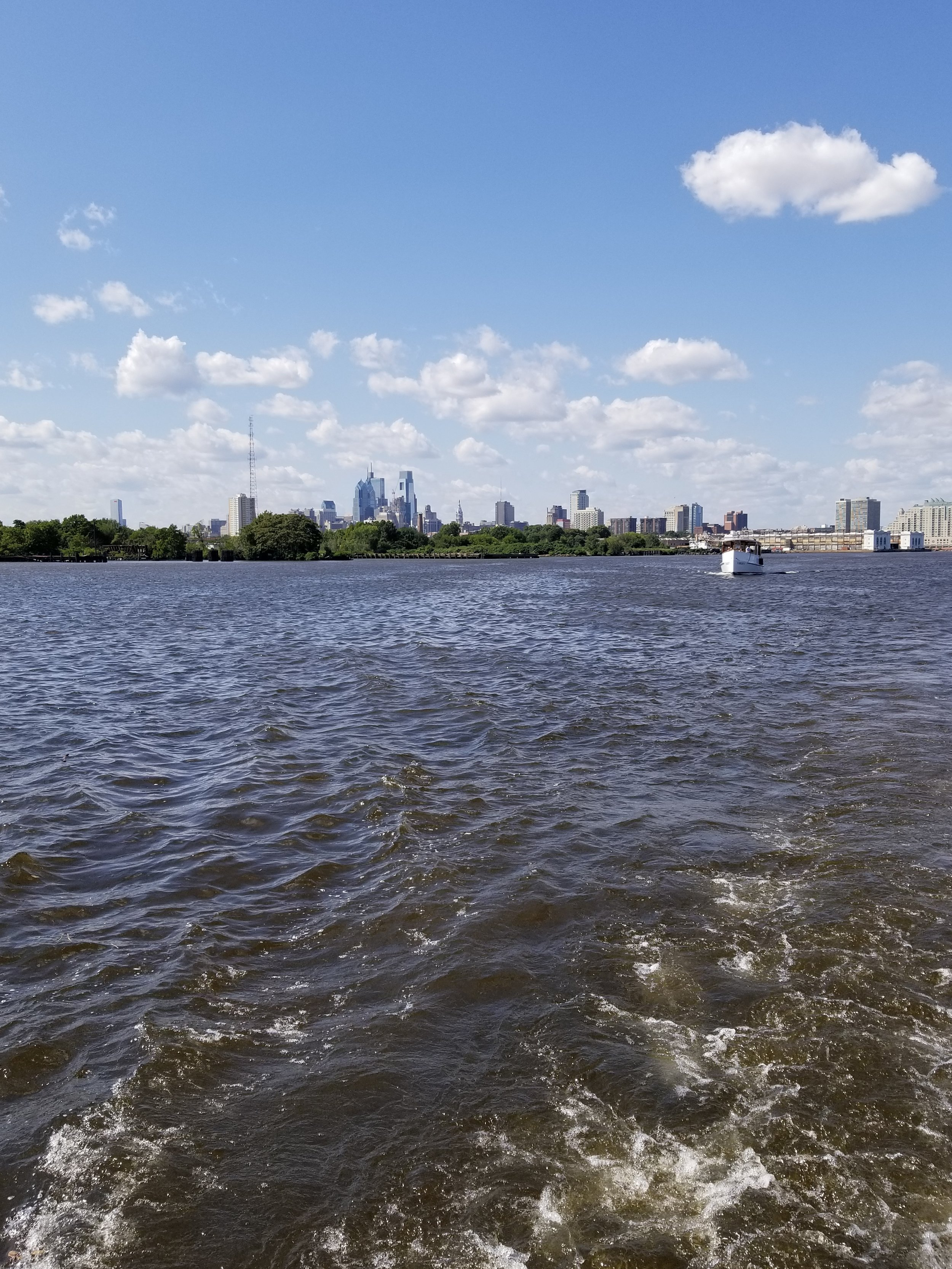 Sailing down the Delaware River with Philadelphia's beautiful skyline slowly fading