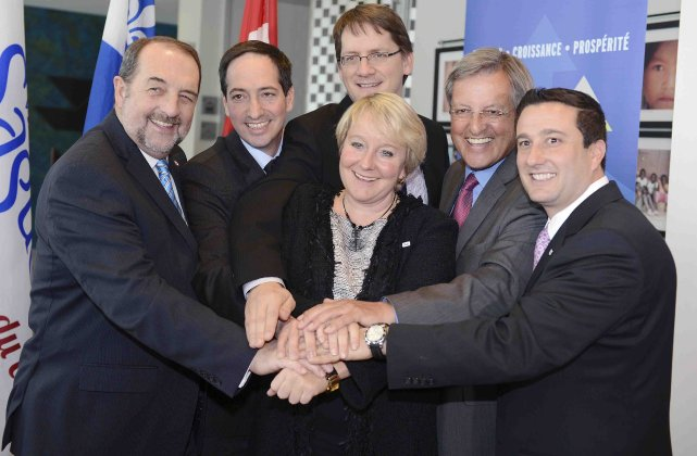 Ministers Denis Lebel, Stéphane Bédard and Sylvain Gaudreault join Martine Turcotte, Vice Chair, Québec for Bell, Mayor Jean Tremblay and John DiNardo, President of Nordia at the announcement.