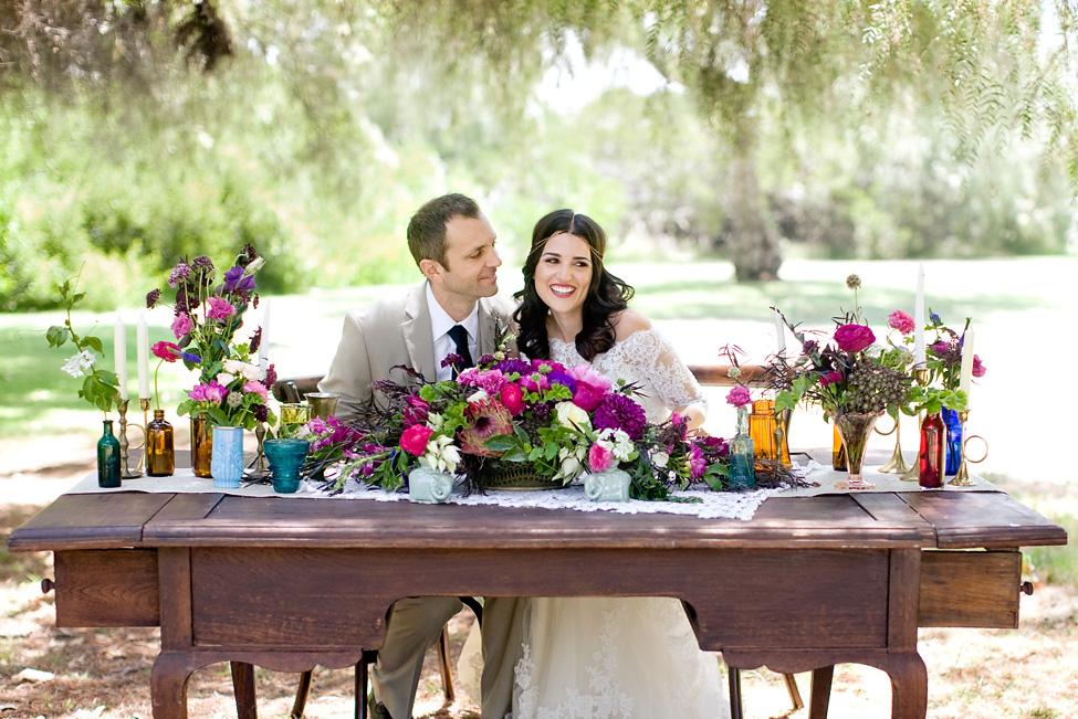 Berry bohemian sweetheart table by San Diego florist, Compass Floral.