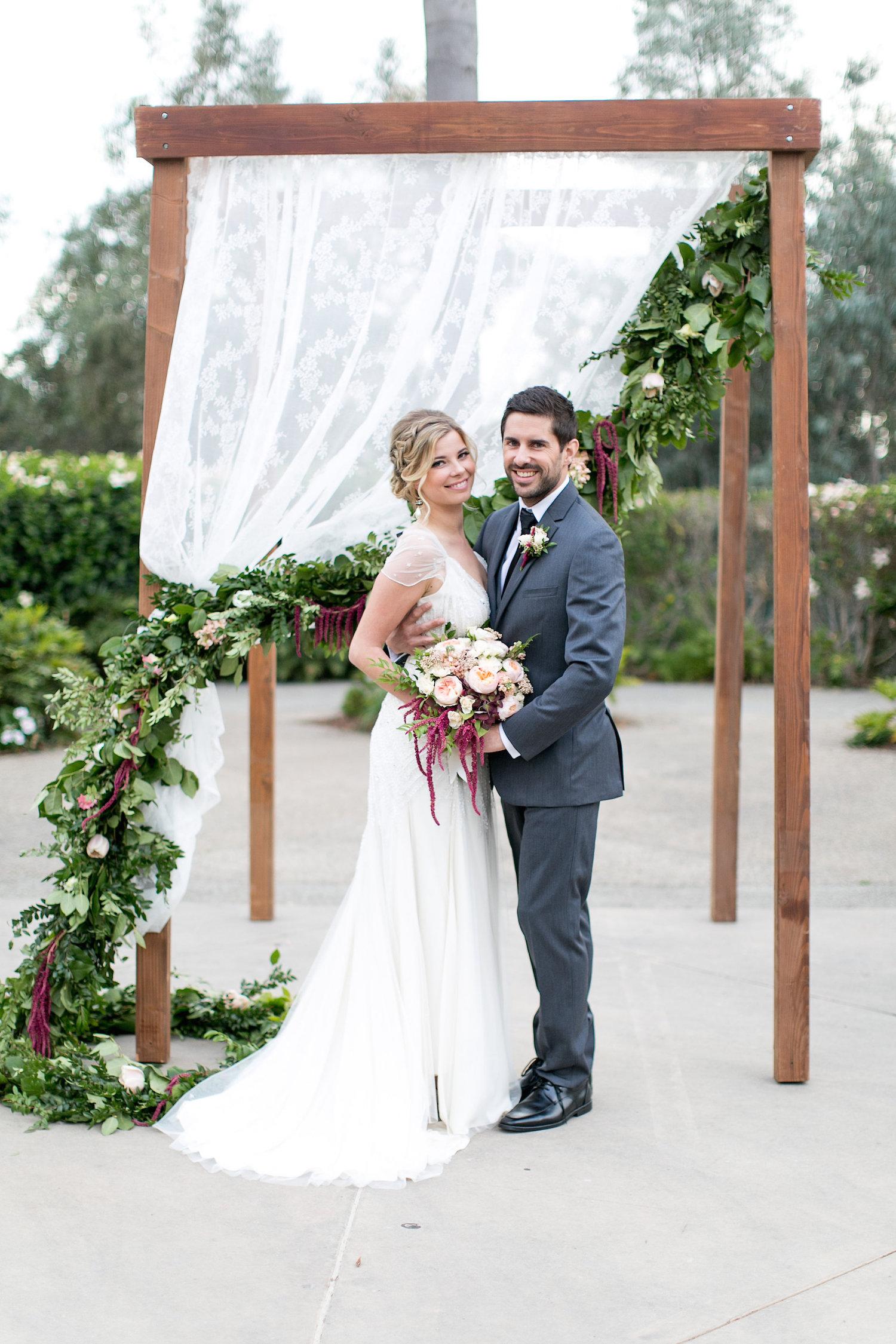 Wedding ceremony garland on chuppah by San Diego florist, Compass Floral.