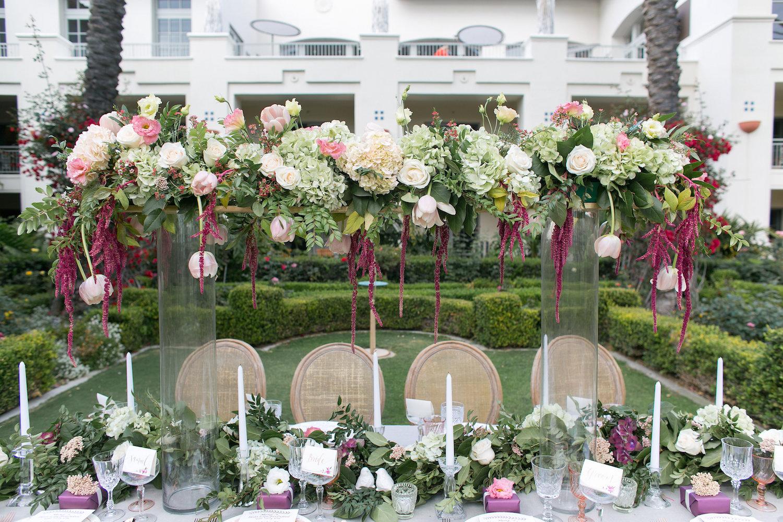 Elevated marsala & blush wedding centerpiece by San Diego florist, Compass Floral.
