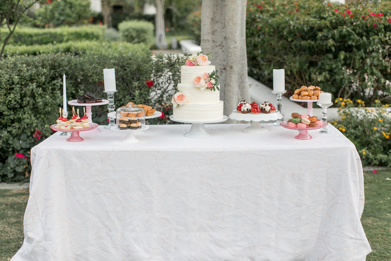 Wedding dessert display at The Park Hyatt Aviara. Florals by San Diego florist, Compass Floral.