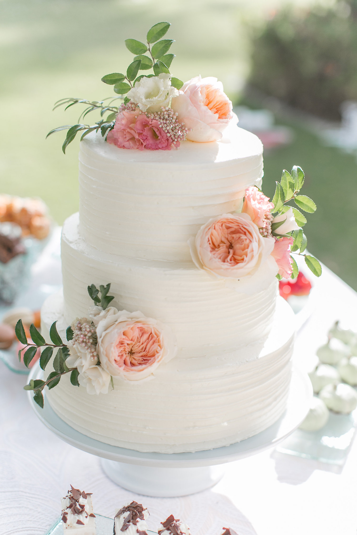 Peach & pink floral wedding cake decorated by San Diego Florist, Compass Floral.