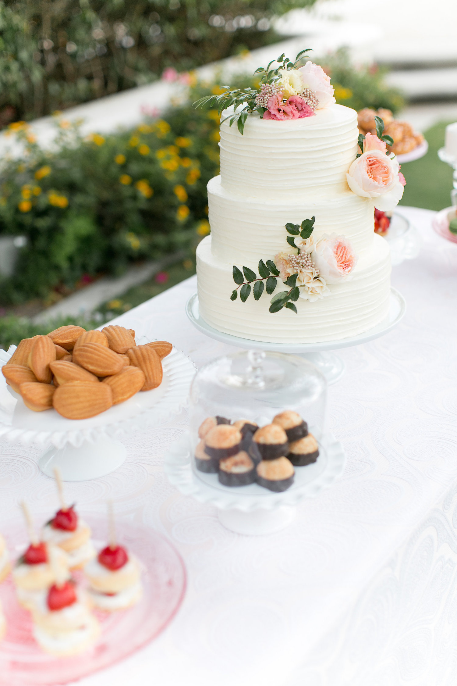 Garden rose wedding cake decorated by San Diego Florist, Compass Floral.