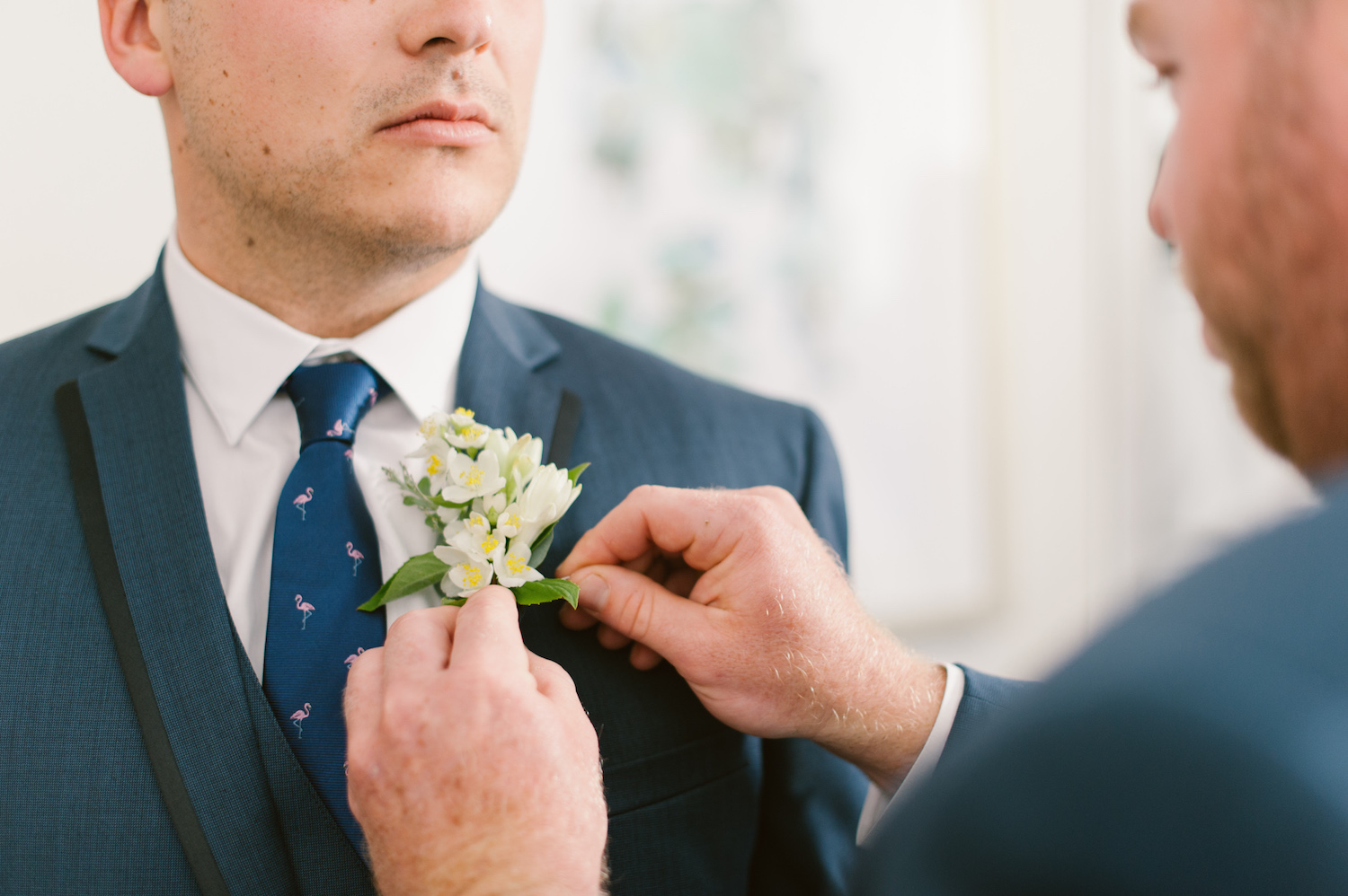 Orange blossom boutonniere by San Diego wedding florist, Compass Floral.