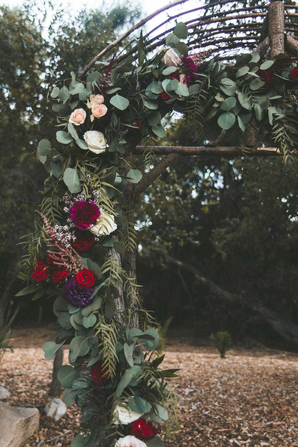 Temecula Creek Inn Moody burgundy &  marsala ceremony garland by San Diego wedding florist, Compass Floral.
