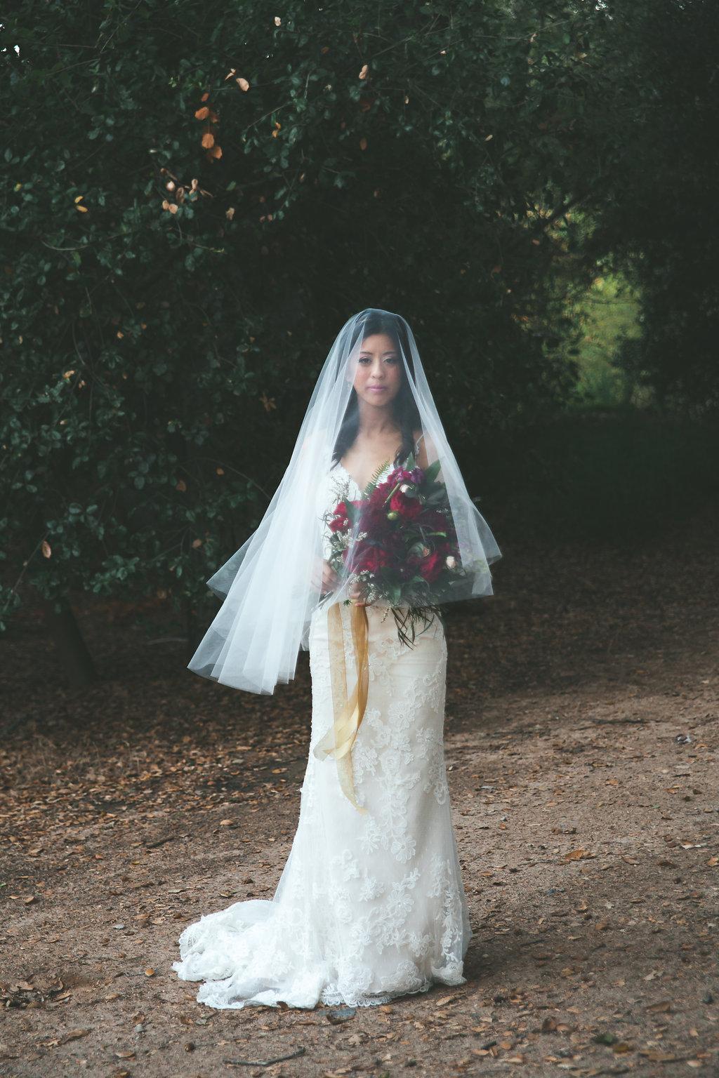 Temecula Creek Inn Moody burgundy &  marsala wedding flowers by San Diego wedding florist, Compass Floral.