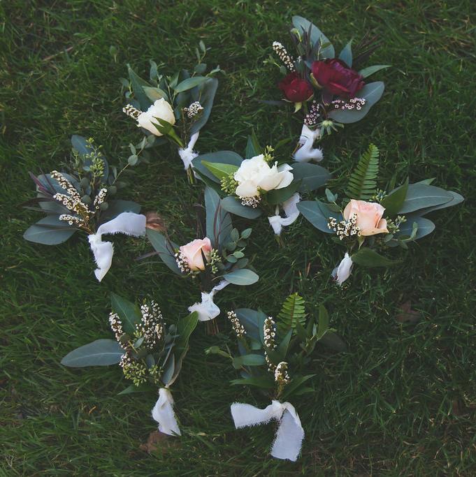 Burgundy, marsala, blush & ivory boutonnieres by San Diego wedding florist, Compass Floral.