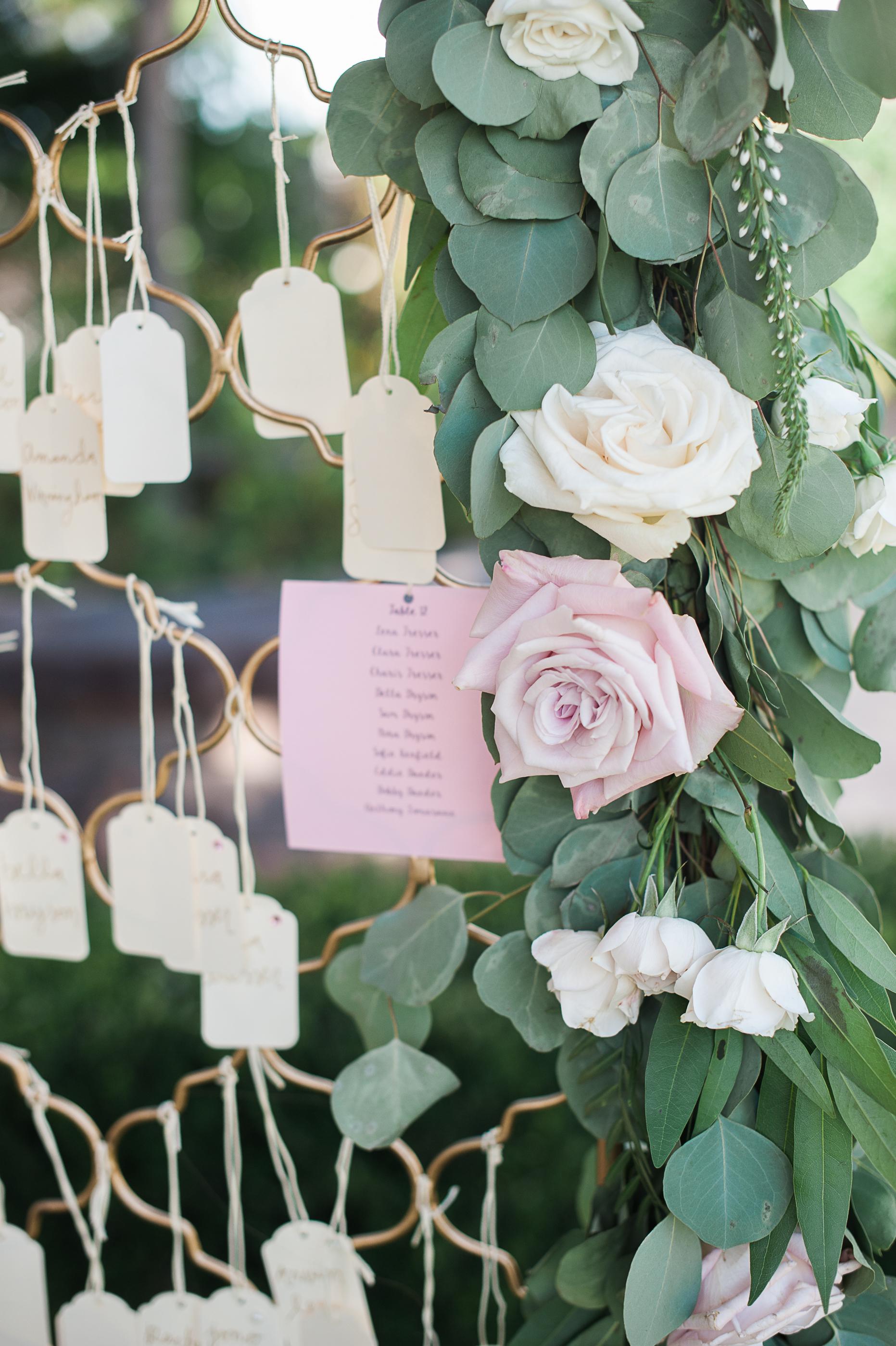 Eucalyptus & rose escort card garland by San Diego Florist, Compass Floral.  Brandi Welles Photography.