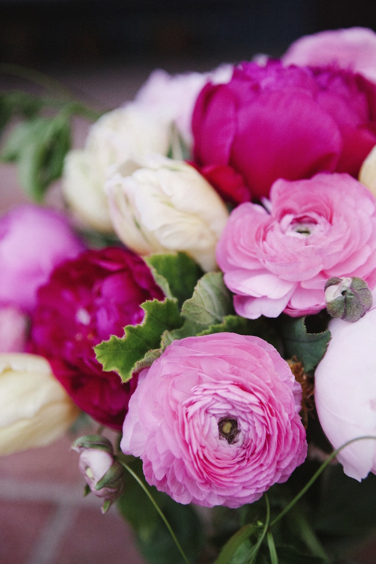 Pink peony, ranunculus & tulips by Compass Floral. Photography by Ashley Williams.