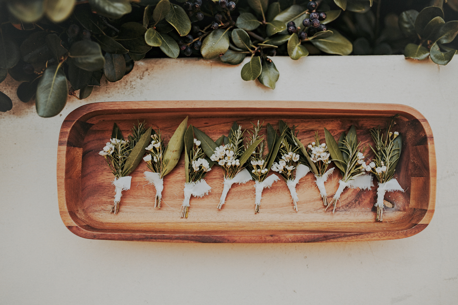 Rosemary boutonnieres by San Diego wedding florist, Compass Floral.