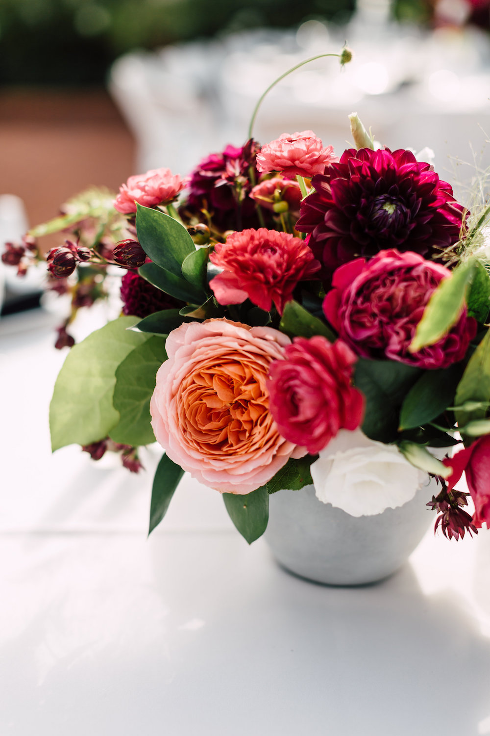 Classic, modern jewel tone centerpiece by Compass Floral. Venue: The Darlington House, La Jolla. Photographer: Plum & Oak